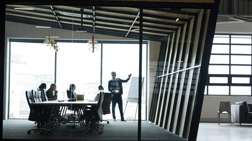People in a glass meeting room